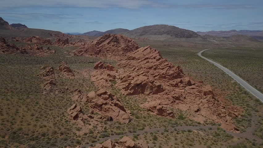 Aerial near Valley of Fire red rock picnic area highway. Near Valley of Fire State Park a public recreation and nature preservation area. Natural ecological tourist tourism destination. | Shutterstock HD Video #27119296