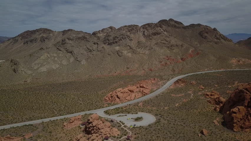 Aerial Nevada desert red rock view area. Scenic desert landscape mountains. Natural ecological destination. Hot arid red multicolored rock formation wilderness. | Shutterstock HD Video #27119350