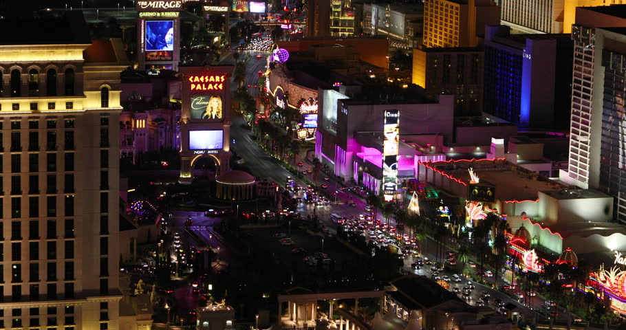 LAS VEGAS, NEVADA - 26 APR 2017: Las Vegas Strip Nevada traffic night casino resorts. Strip attraction, tourism. Gambling, party and destination for conventions, business. Sin City. | Shutterstock HD Video #27158077