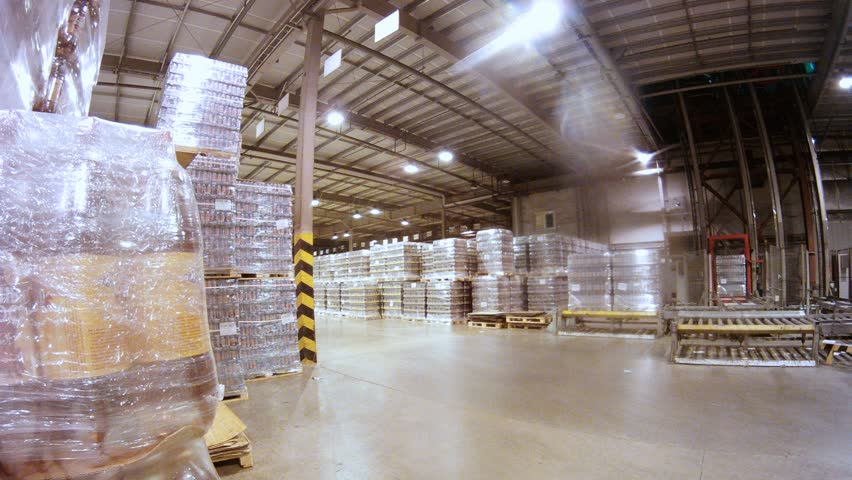 Loader transports containers with kvass in warehouse of nonalcoholic plant, time lapse