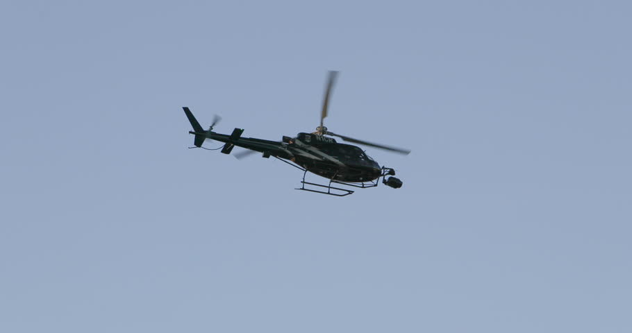 LAS VEGAS, NEVADA - 26 APR 2017: Police helicopter over Las Vegas Nevada Strip. Spotlight and cameras for pursuit of criminals. Aerial follow vehicles overhead of a dangerous situation on the ground. | Shutterstock HD Video #27174043