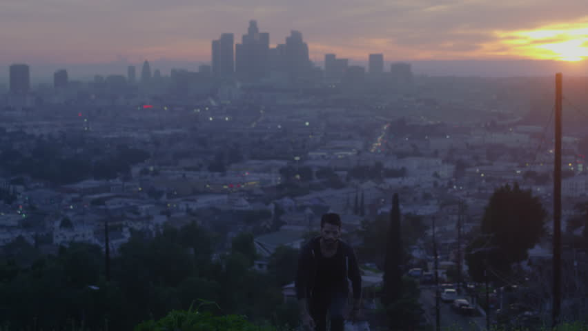 Man Running Up Hill At Sunset Skyline Los Angeles_2 | Shutterstock HD Video #27181702