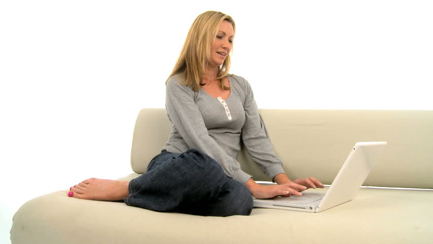 Attractive blonde female works on her laptop at home - HD stock video clip