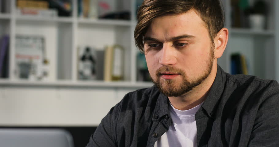 Portrait of young attractive man uses a laptop in the office | Shutterstock HD Video #27263062