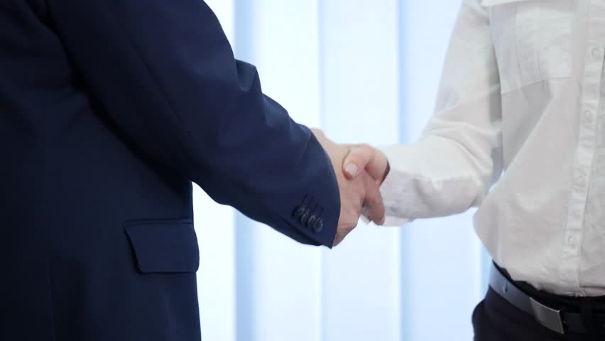 Two business partner shake hands when meeting. In slow motion.   Shutterstock HD Video #27351757