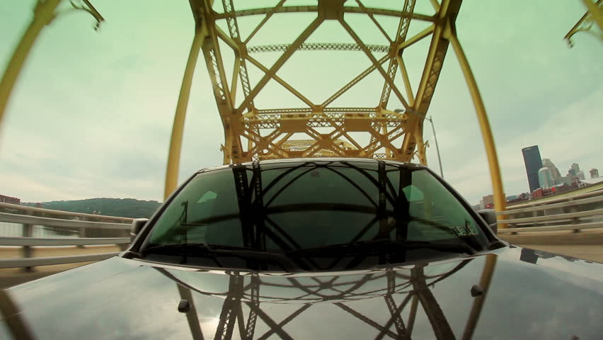 Driving on the 16th Street Bridge over the Allegheny River in Pittsburgh, Pennsylvania.  Fish eye view, camera attached to the hood of a car.
