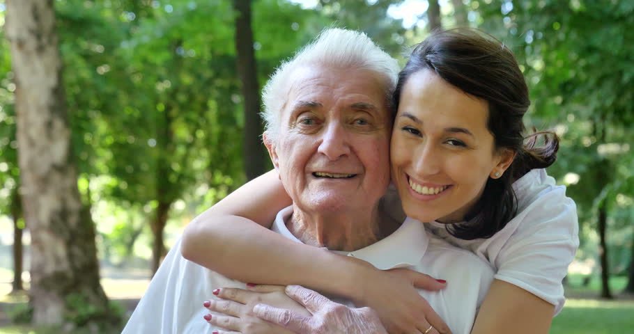Granddaughter, nurse, caring for the elderly, girl (woman) hugging grandfather, smiling, happy, walking in the park. Concept: boarding house, sanatorium, a house for the elderly, help for the elderly. | Shutterstock HD Video #27592786