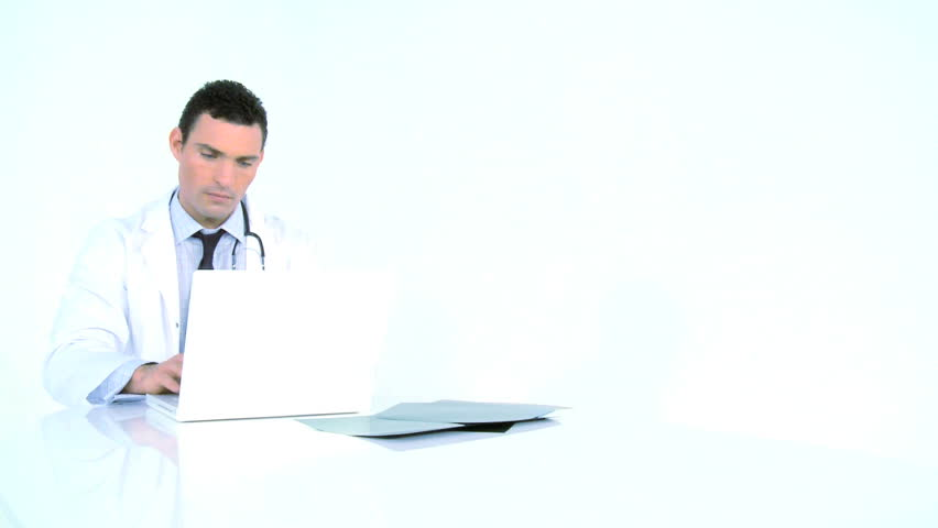 Young male doctor working with patient records - HD stock video clip