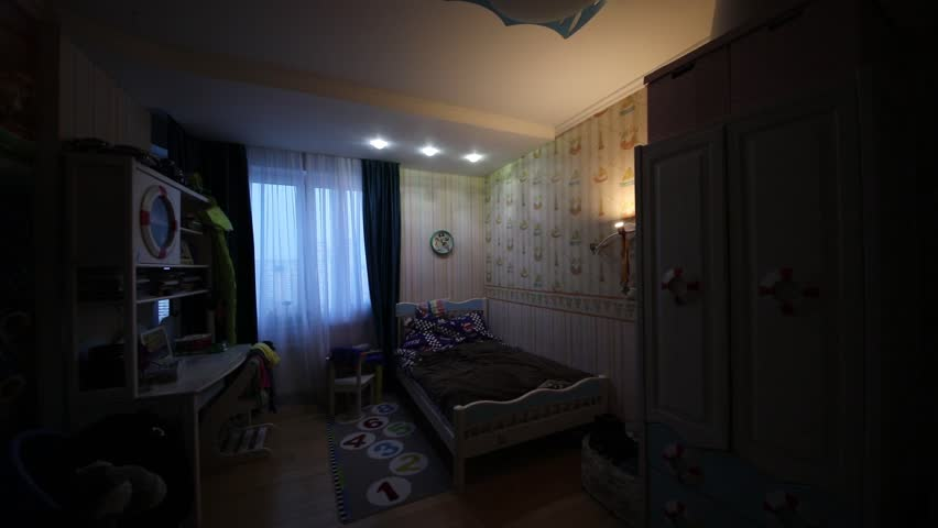 Turning on and off light in room with marine furniture for boy #27748738