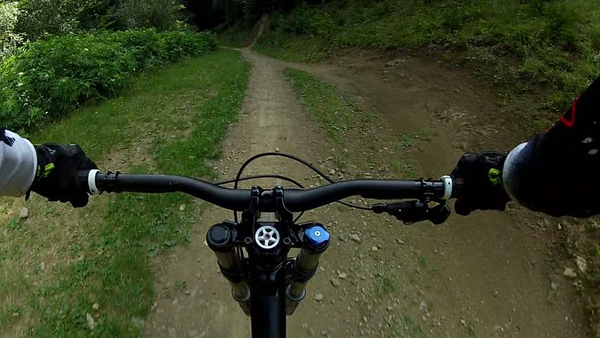 DoDownhill front view. Ride a bike over terrain pov.