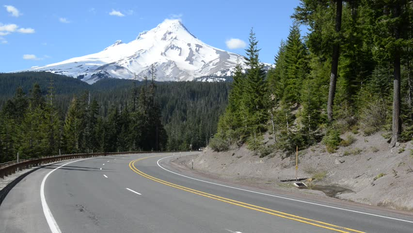 PORTLAND OREGON CIRCA MAY 2017. Despite the media portrayal of Mount Hood being an easy walkup hike, any route is a technical climb on steep snow and ice, crevasse risk and volatile weather. | Shutterstock HD Video #27882703