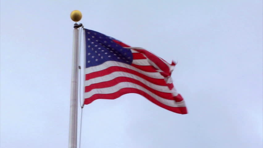 American flag in slow motion - Wide to Closeup