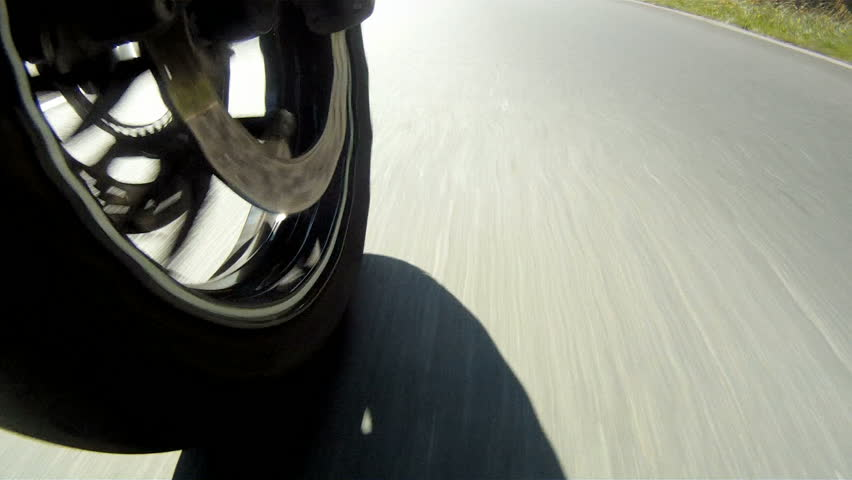 Motorcycle Wheel Close-up racing on the highway | Shutterstock HD Video #2792134