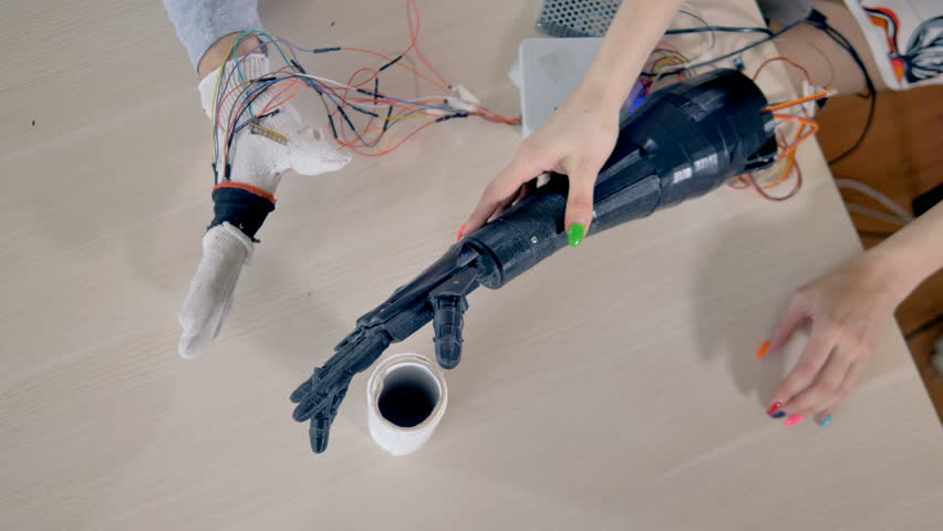 Paper towels being lifted by bionic arm and then fallen down. View from above. 4K. | Shutterstock HD Video #27942625