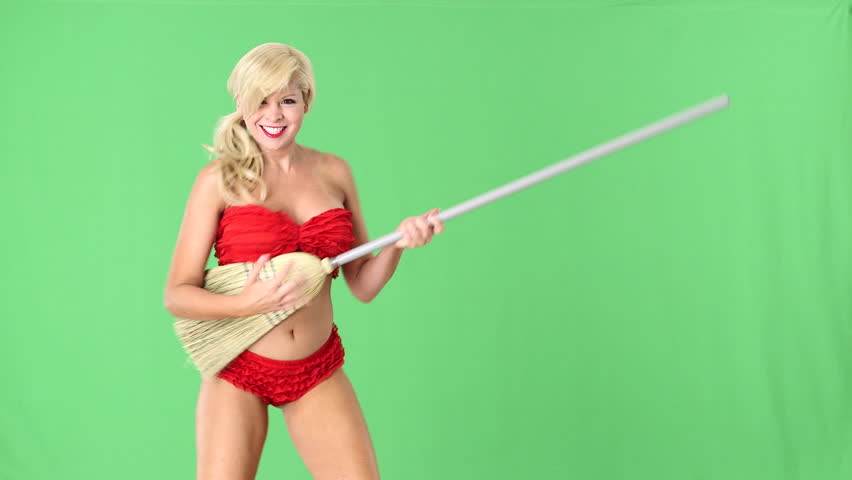 Sexy blond girl in red bikini playing guitar on broomstick and dancing - HD stock footage clip