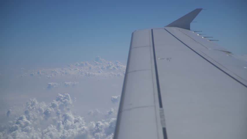 Wing of a flying aircraft over clouds, 4K Aerial Video Footage #28051291