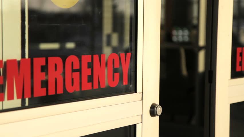 Emergency Room Doors Close Red Letters Of Emergency