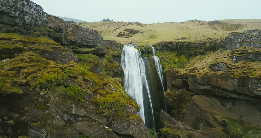 Aerial view of the waterfall Gljufrabui in Iceland. Copter flying over the green valley and river falling down. #28102861
