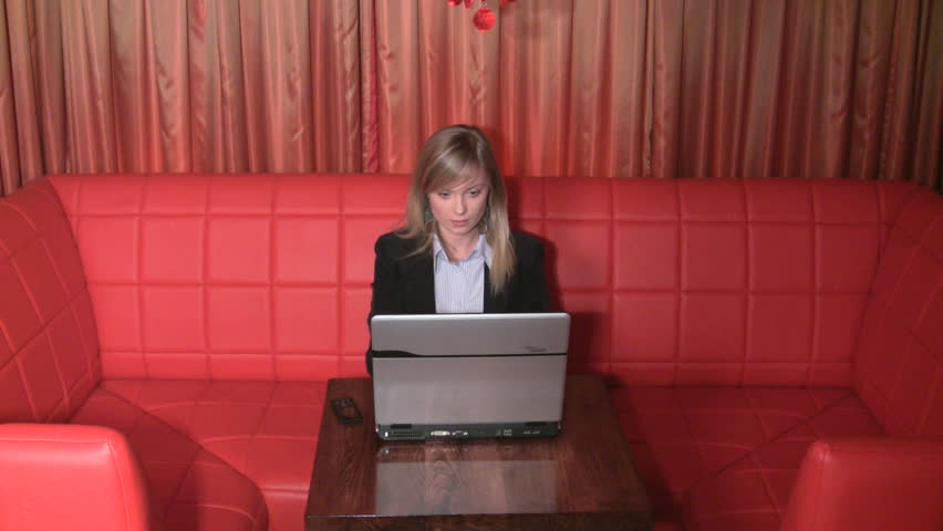 beautifull businesswoman using a laptop and a cellphone - HD stock footage clip
