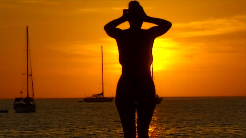 topless woman walk at the beach in sundown - slow motion - slightly soft shot - HD stock video clip