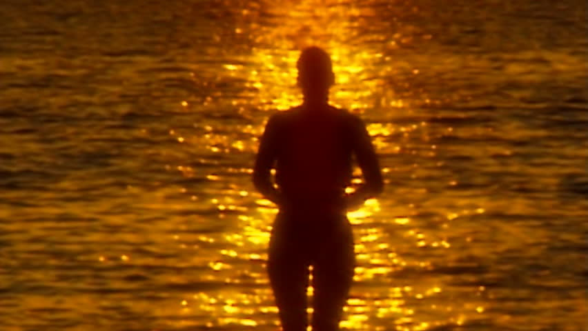 topless walk out water defocus in slow motion - slightly soft - HD stock video clip