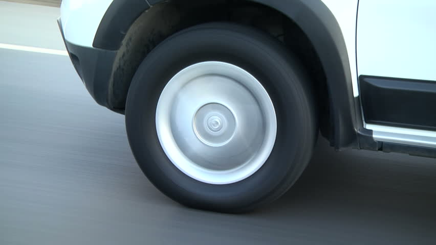 Car wheel is turning in the road