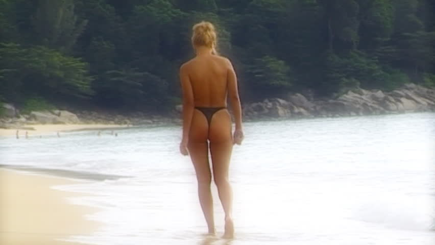 topless woman walking away - slow motion - filtered soft shot - Hamilton style - HD stock video clip