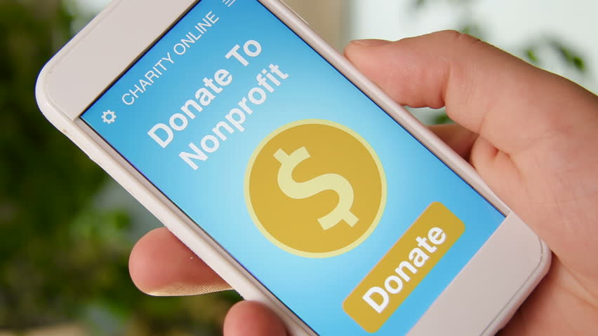 Man making an online donation to nonprofit organization using charity applicaiton on smartphone