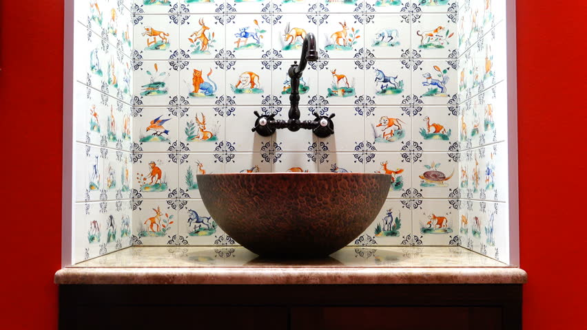 Washing hands in a designer washbasin with a stone and steel bowl. | Shutterstock HD Video #28617256