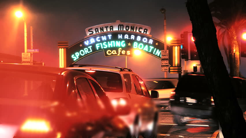 SANTA MONICA - JULY 15: Time lapse of cars and tourists passing by the iconic fishing pier in Santa Monica, California on July 15th, 2011. Zoom in to sign - HD stock footage clip