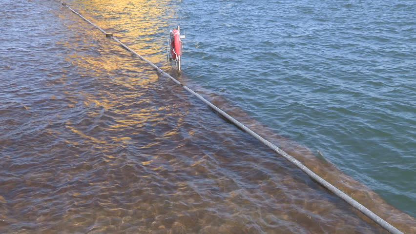 Toronto, Ontario, Canada July 2017 High water levels on lake Ontario submerge boardwalk at waterfront in Toronto  | Shutterstock HD Video #28644076