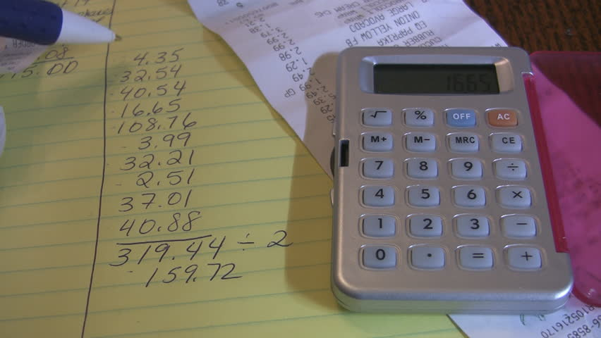Home finances with calculator and receipt.