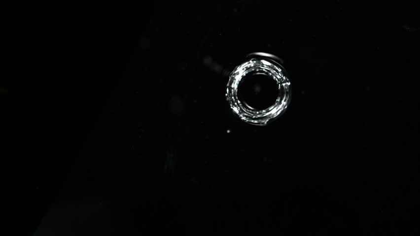 Water drops making ripple shooting with high speed camera, phantom flex.