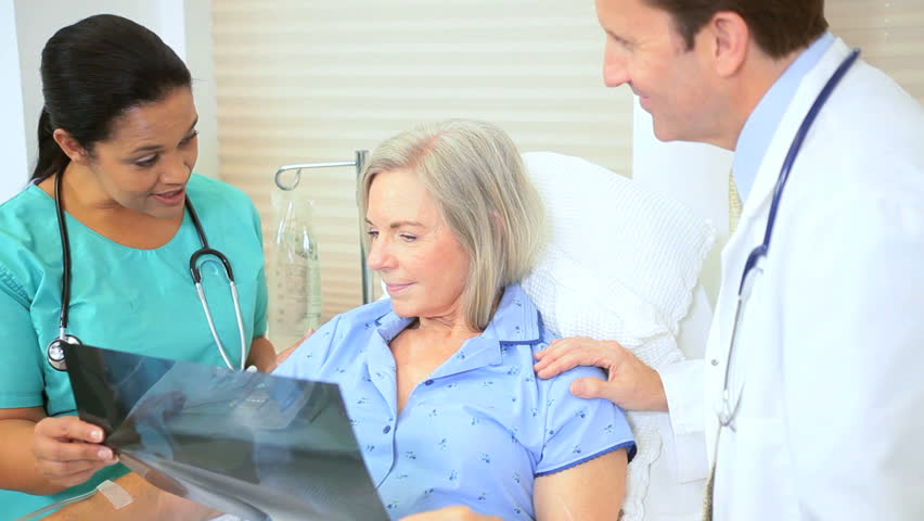 Hospital radiology staff discussing x-ray results older female patient | Shutterstock HD Video #2869984
