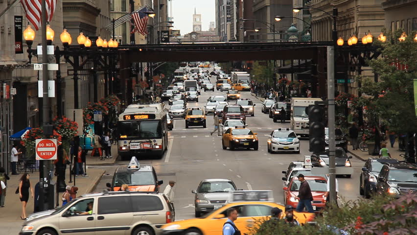 CHICAGO - CIRCA SEPTEMBER 2012: Looking down a crowded downtown Chicago street,