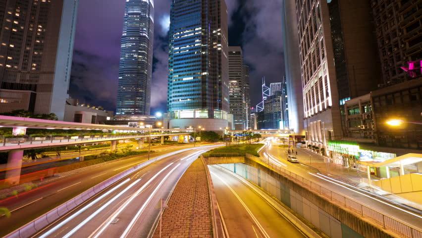 Street traffic in Hong Kong at night, timelapse in motion