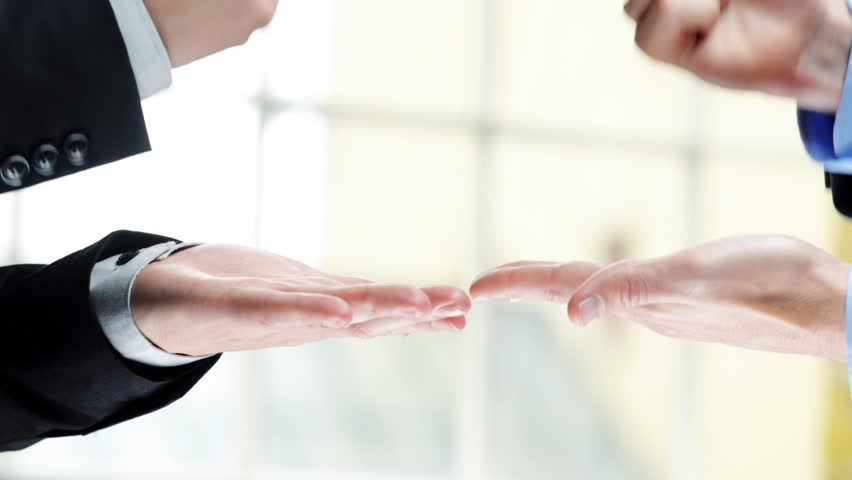 Rock paper scissors being played by two businessmen high definition video   Shutterstock HD Video #2880226