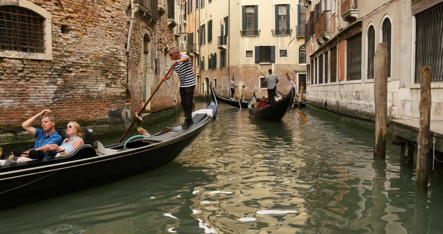 VENICE, ITALY - CERCA 2017: Venice, Italy's Veneto region. Also known as a famous place for sweethearts, lovers, artists and poets, Venice is a magical city with many gondola riding tourists. | Shutterstock HD Video #28840843
