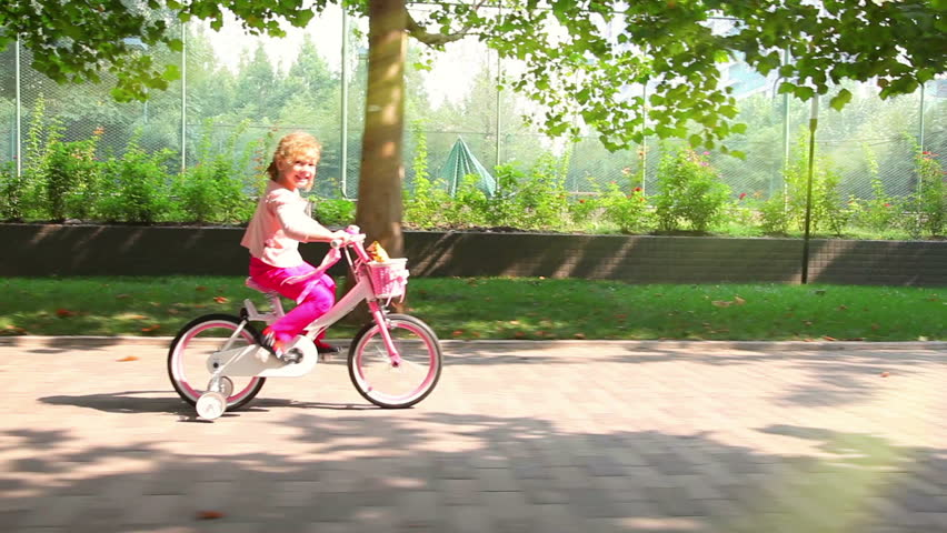 Little girl on bike - HD stock footage clip