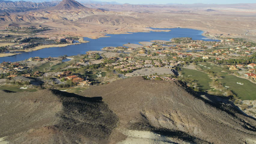 Aerial view desert town residential homes on the shores of Lake Mead reservoir Southeast Las Vegas Nevada USA RED EPIC | Shutterstock HD Video #29009260
