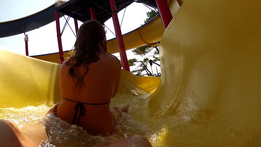 Watersliding. Father and daughter on the waterslide.