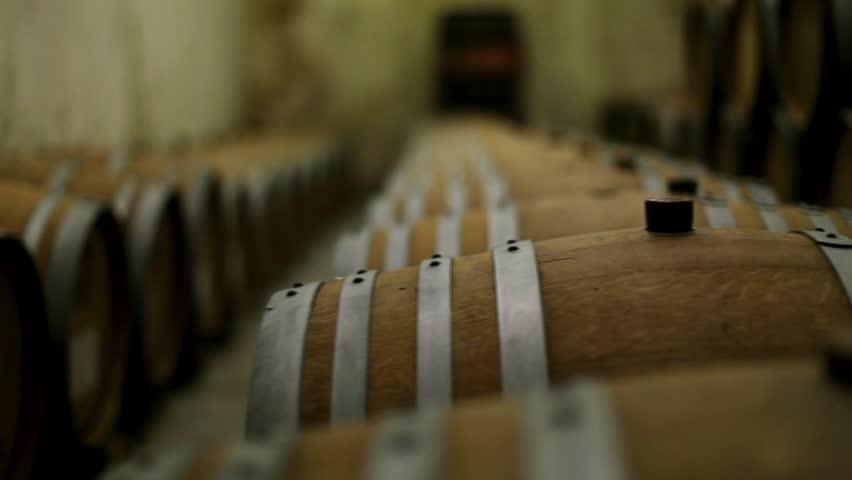 Oak barrels of wine in the cellar