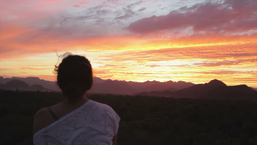 Woman watching sunset over the mountains in Baja California, Mexico - HD stock footage clip