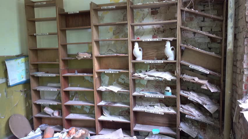 Kopani village, Chernobyl, Ukraine - 17th of June 2017: Visit to Chernobyl exclusion zone - 4K Book shelves in the library of abandoned nursery at the Chernobyl zone  | Shutterstock HD Video #29231110