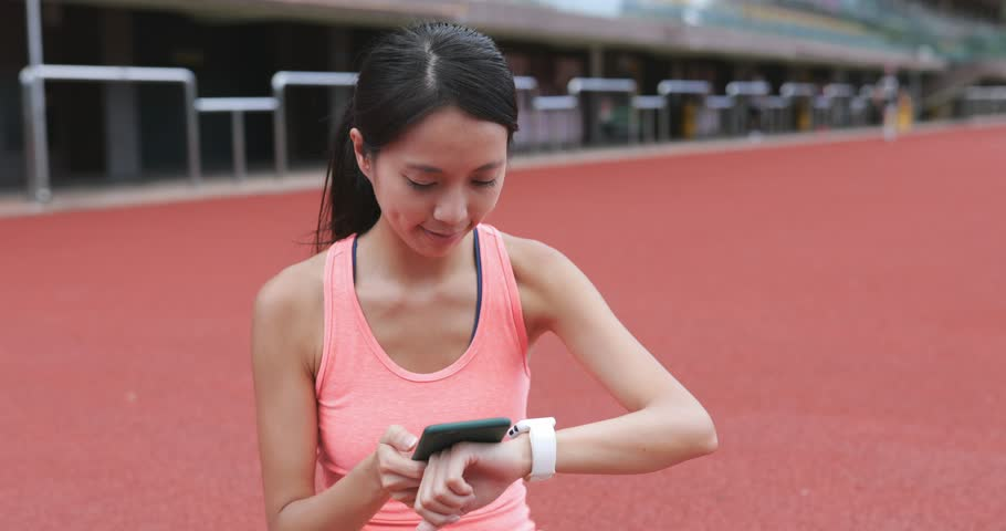 Sport woman using smart watch in sport complex | Shutterstock HD Video #29232631