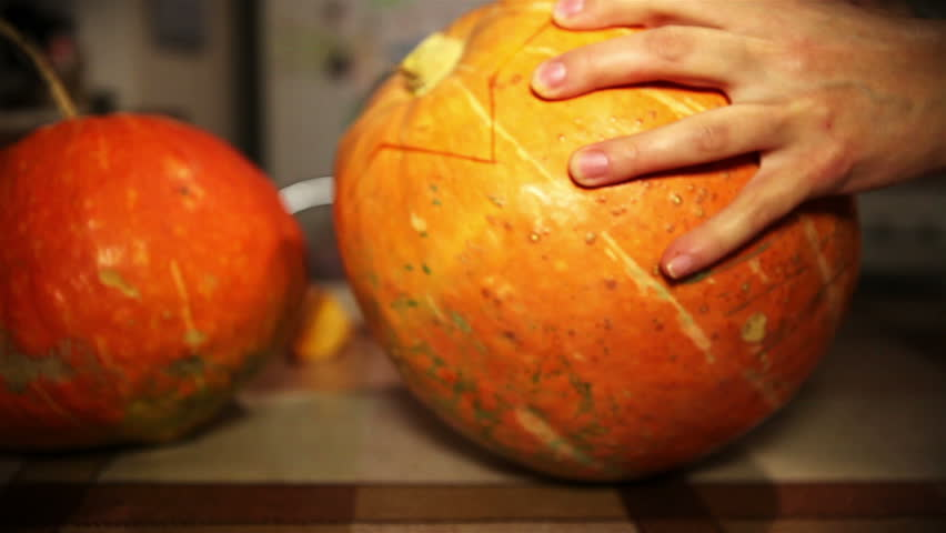 Hallowing Jack-o'-lantern prepare carving Process in the cozy kitchen - HD stock footage clip