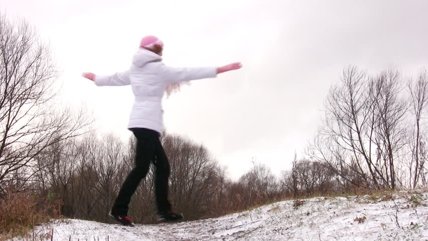 Woman dancing rotating on snow meadow.  - HD stock video clip