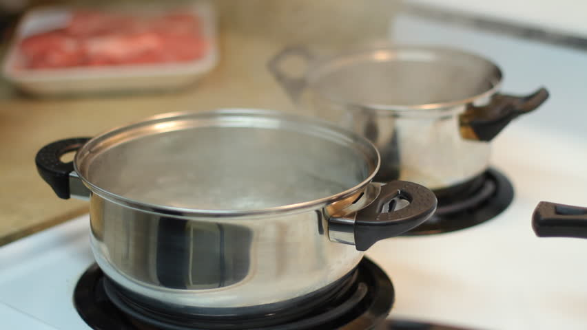 pot full of boiling water on the electric stove stock footage video 2955988 shutterstock. Black Bedroom Furniture Sets. Home Design Ideas