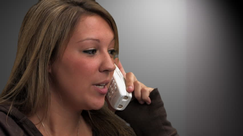 A college-aged girl talks on a cordless phone. - HD stock footage clip