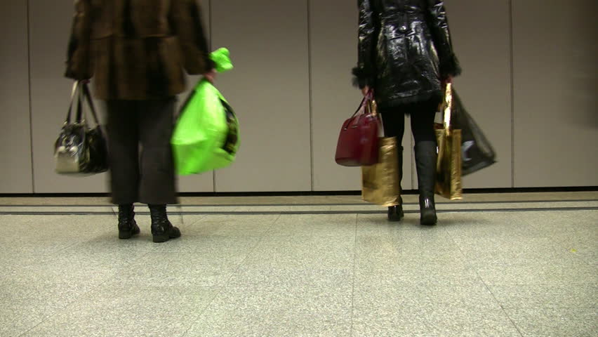 Woman with bags. Walking people. Legs. Subway.  - HD stock video clip